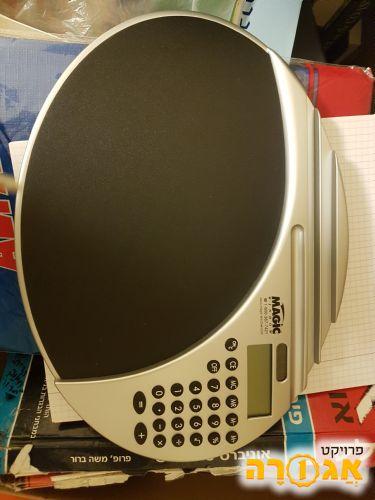 משטח קשיח לעכבר מחשב עם מחשבון ידני פשוט